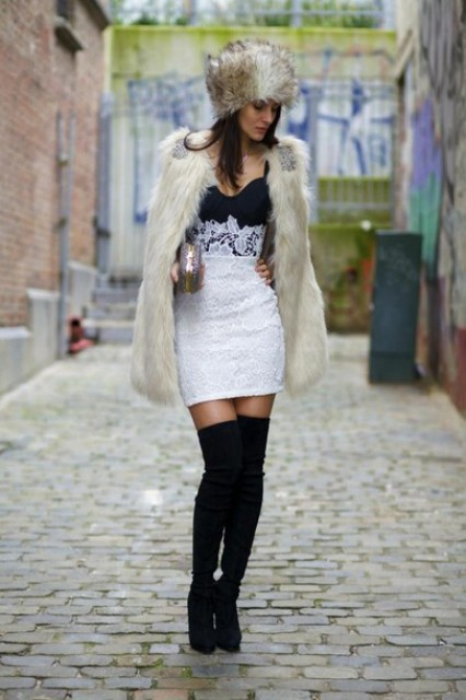 With lace mini dress, black over the knee boots and fur jacket