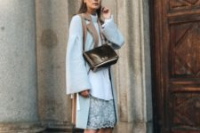With light blue lace knee-length skirt, sweater, black bag and brown suede lace up heeled boots