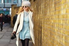 With light blue sweater dress. white coat and bag