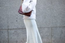 With marsala hat, marsala bag, white sweater and black boots