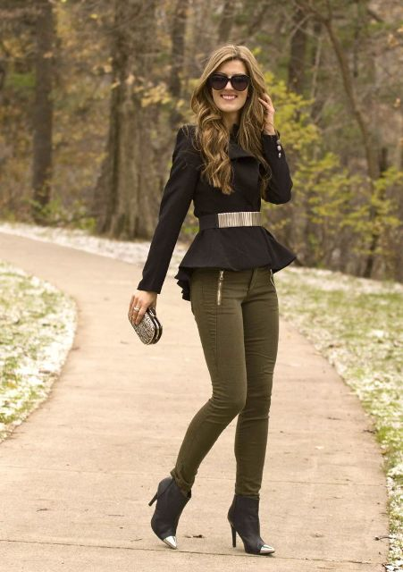 With metallic belt, small clutch, olive green skinny pants and ankle boots