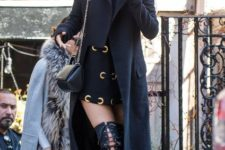 With mini dress, maxi coat and lace up over the knee boots