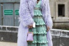 With mint green midi dress, lilac mini bag and high heels