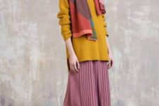With mustard yellow long sweater, pink pleated midi skirt and pumps