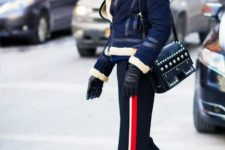 With navy blue jacket, two colored boots and embellished bag