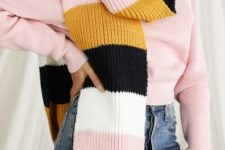 With pale pink sweater and high-waisted jeans