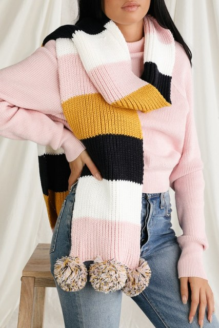 With pale pink sweater and high waisted jeans