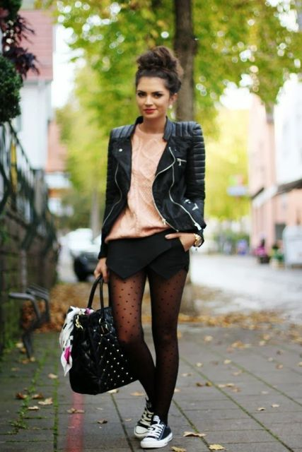 With pale pink sweater, black leather jacket, sneakers, tote bag and shorts