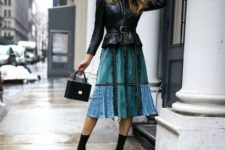 With patchwork midi skirt, black bag and black sock boots