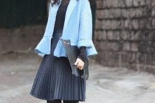 With pleated skirt, hot pink shoes, black blouse and clutch