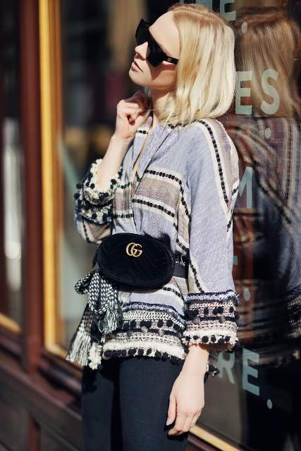With printed cardigan and dark colored pants