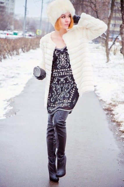 With printed dress, white faux fur jacket and black leather over the knee boots