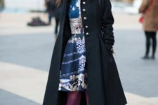 With printed knee-length dress, black coat, purple tights and black ankle boots