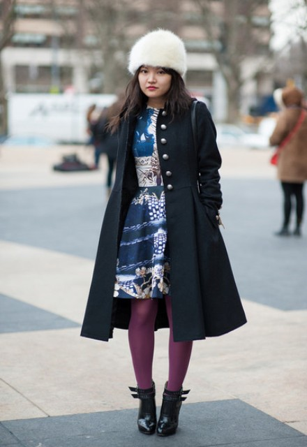With printed knee length dress, black coat, purple tights and black ankle boots