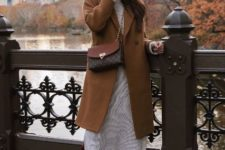 With printed midi dress, patent leather high boots and brown coat