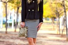With printed mini skirt, golden clutch, wide brim hat and black shoes