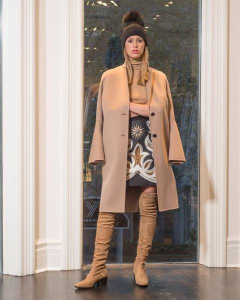 With printed skirt, beige turtleneck, hat and suede over the knee boots