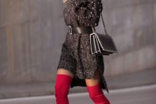 With red over the knee boots and black chain strap bag