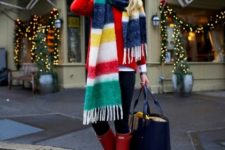With red sweater, black leggings, red high boots and navy blue tote bag