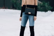 With skinny jeans, black over the knee boots and chain strap bag