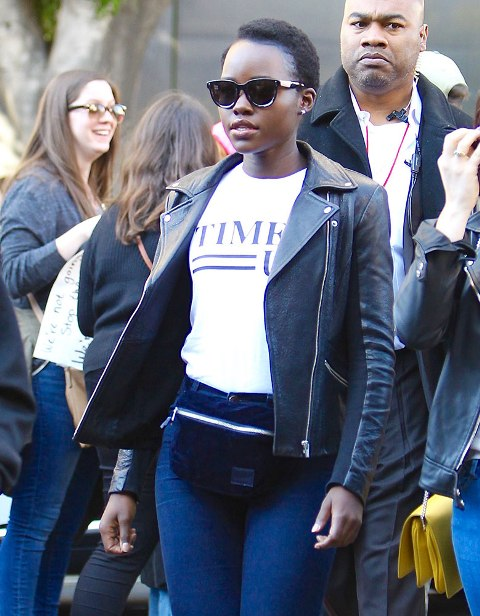With skinny jeans, labeled t shirt and black leather jacket