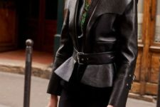With sporty pants, black leather bag and green blouse