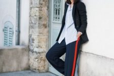With striped loose shirt, black blazer and sneakers