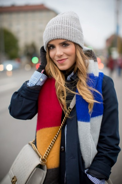 With striped shirt, gray hat, chain strap bag and navy blue coat