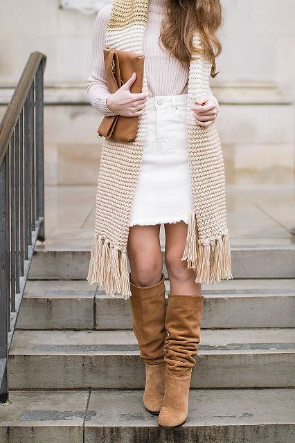 With sweater, oversized fringe scarf, brown leather clutch and brown suede high boots