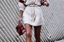With white ankle boots and marsala bag