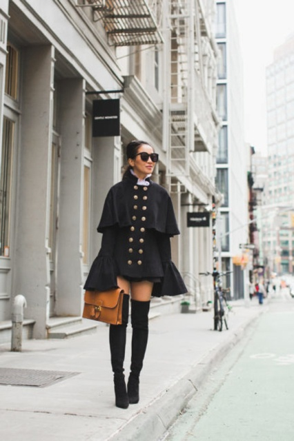 With white blouse, black mini skirt, brown leather bag and black over the knee boots