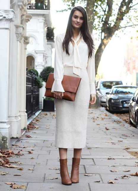 With white blouse, brown clutch and brown ankle boots