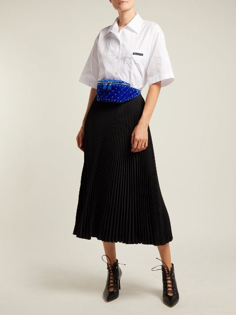 With white button down shirt, black pleated midi skirt and lace up boots
