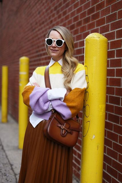 With white button down shirt, brown pleated skirt and brown leather crossbody bag
