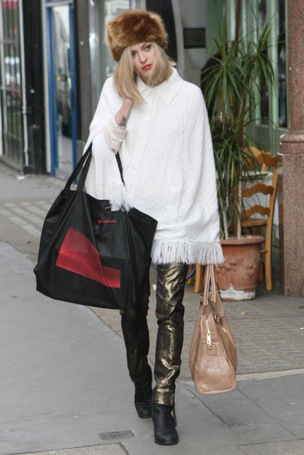 With white loose sweater, metallic pants, black boots and beige bag