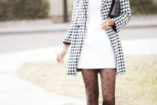 With white mini dress, printed coat, black wide brim hat, black clutch and boots