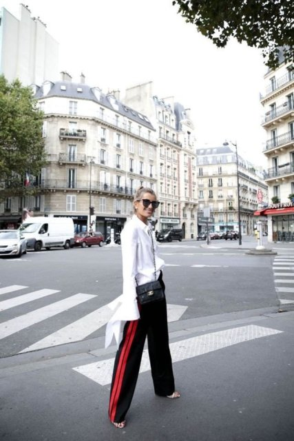 With white oversized blouse, high heels and chain strap bag