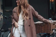 With white pants, checked coat and beige sweater