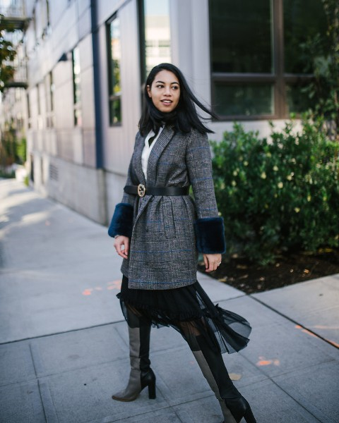 With white shirt, black airy skirt and high boots