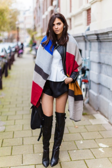With white shirt, black shorts, black leather jacket, bag and black over the knee boots