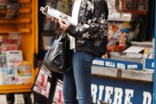 an outfit with a floral bomber jacket that is perfect for winter