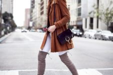 With white skinny pants, gray suede over the knee boots and black bag
