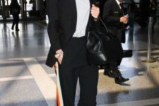 With white t-shirt, black blazer, high heels and leather bag