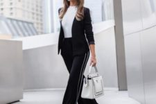 With white t-shirt, black blazer, white bag and shoes