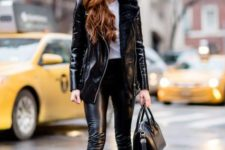 With white t-shirt, black leather skinny pants, black boots and black bag