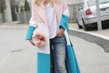With white t-shirt, cuffed jeans, beige and black shoes and faux fur clutch
