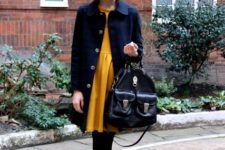 With yellow mini dress, black tights, navy blue coat, black bag and black embellished shoes