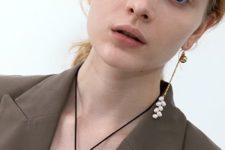 a beautiful single earring with a gold bead, a chain and some white pearls on it