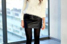 a black fuzzy top, a black leather mini skirt, black tights and black booties for a monochromatic look