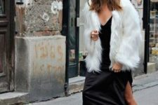a black slip dress, a white fur coat, black combat boots and socks for an extravagant monochromatic look